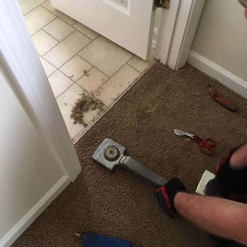 Repairing carpet in threshold between rooms where carpet is torn or worn - Greenville, SC