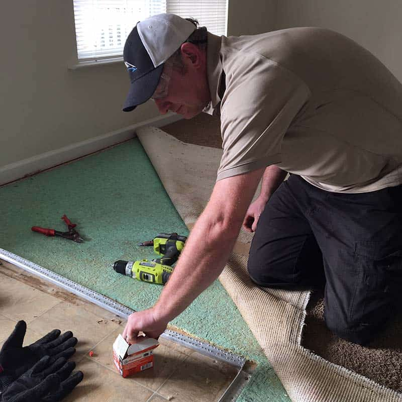 Damaged carpet repair in Greenville, SC threshold repair tack strip replacement